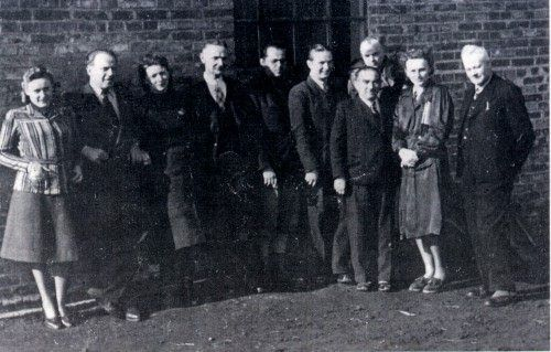 Schindler (second from left) with his Polish staff in Emalia 1940